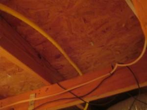 CSST under roof decking